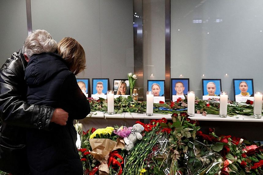 Relatives of the flight crew of the plane that crashed in Iran, mourning at a memorial at the Boryspil International Airport outside Kiev, Ukraine, on Wednesday. PHOTO: REUTERS