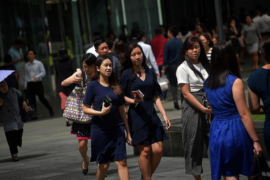 The study noted that more men have jobs with higher levels of wage increases while women tend to be over-represented in roles with lower wage hikes. ST PHOTO: KUA CHEE SIONG