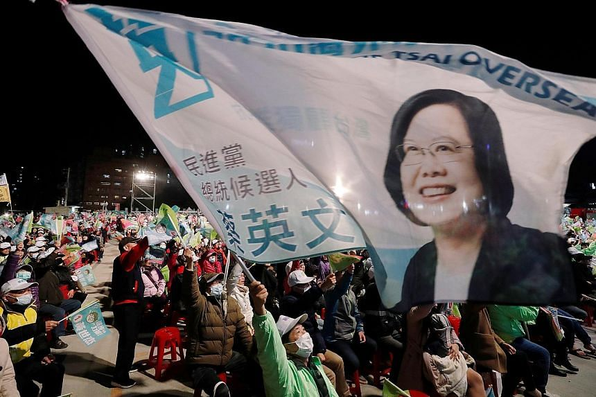 Supporters of Taiwan's President Tsai Ing-wen and her Democratic Progressive Party at a campaign rally on Wednesday. PHOTO: REUTERS