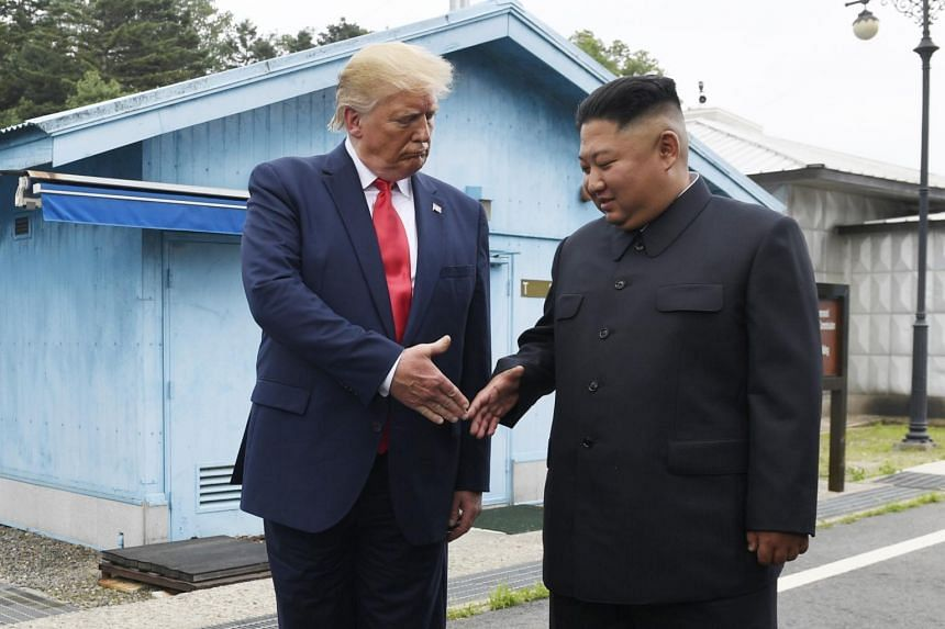 A photo taken on June 30, 2019, shows US President Donald Trump with North Korean leader Kim Jong Un at the border village of Panmunjom in the demilitarised zone.
