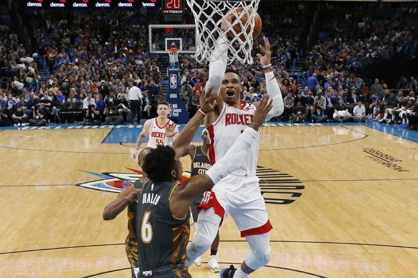 Houston Rockets guard Russell Westbrook (in white) in action against Oklahoma City Thunder, on Jan 9, 2020.