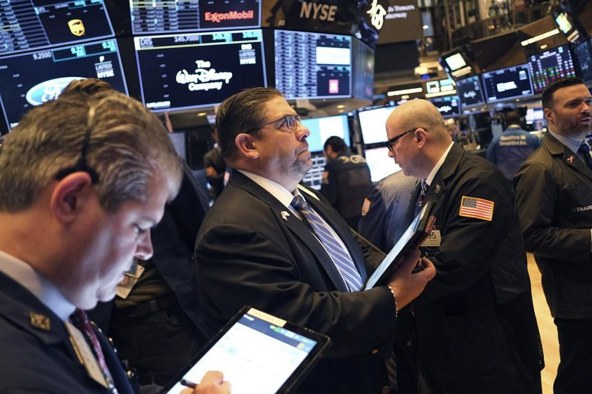 Traders work on the floor of the New York Stock Exchange in New York, on Jan 8, 2020.