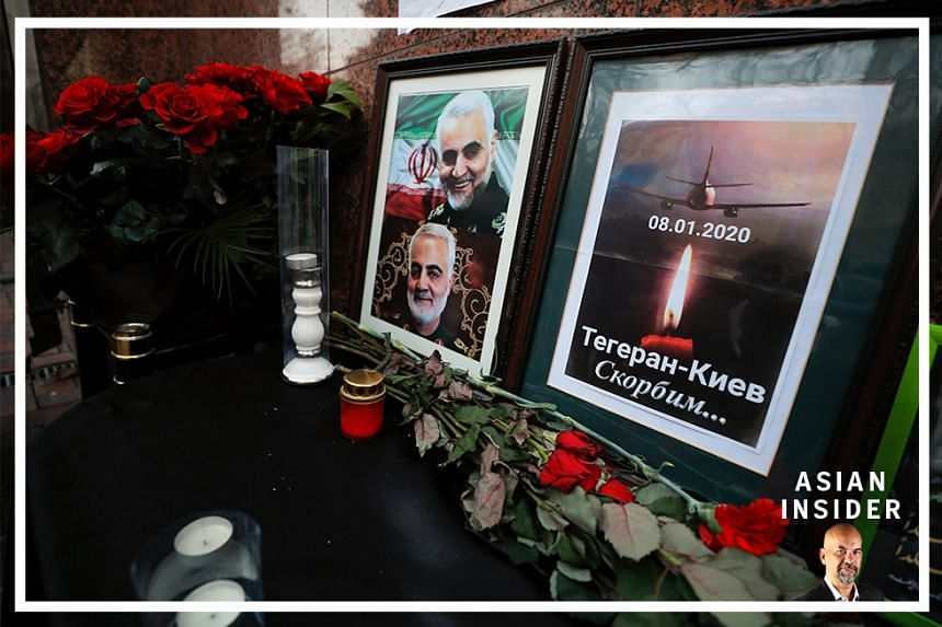 Flowers, symbolic airplane image and portrait of the top Iranian General Qasem Soleimani, head of the IRGC's Quds force, who was killed by a US drone strike in Baghdad are seen in front of the Iranian embassy in a tribute to the airplane crash victim