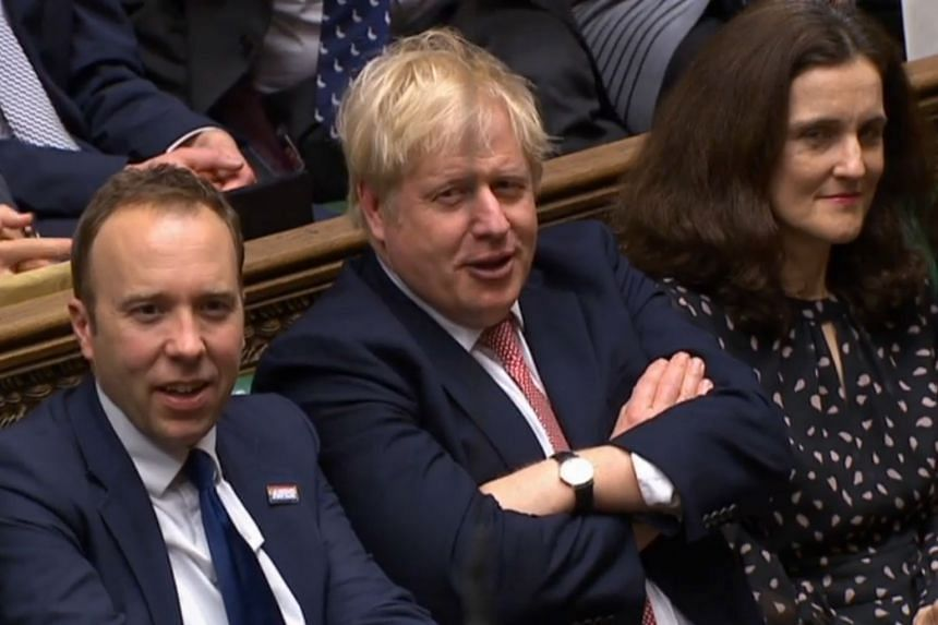 British Prime Minister Boris Johnson (centre) reacts after his Government won the vote.