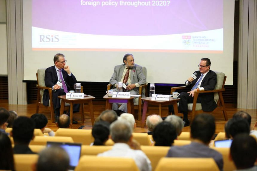 Dr Bates Gill (left) and Professor Michael Brown (right) at the RSIS Distinguished Public Dialogue moderated by Dr Adam Garfinkle at NTU@One-north, on Jan 10, 2020.