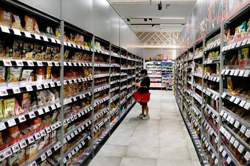 At FairPrice, shoppers can pick up groceries even on the first day of Chinese New Year as 114 of its stores will be open.