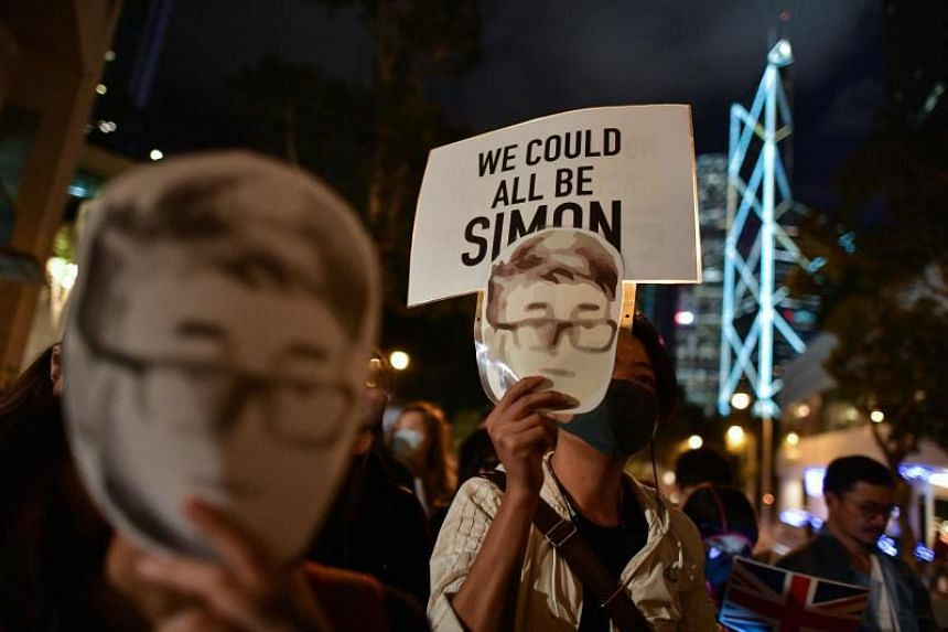 Pro-democracy demonstrators, wearing masks depicting former British consulate worker Simon Cheng, gathering outside the British Consulate-General building in Hong Kong on Nov 29, 2019,