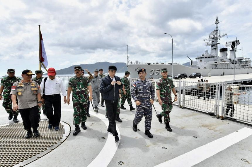 A handout photo made available by the Indonesian Presidential Palace shows Indonesian President Joko Widodo (centre) visiting a military base in the Natuna islands, near the South China Sea, on Jan 8, 2020.