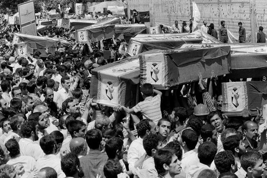 In this July 7, 1988 file photo, mourners carry coffins through the streets of Teheran, Iran, during a mass funeral for the victims aboard Iran Air Flight 655, which was shot down by the USS Vincennes in the Persian Gulf.