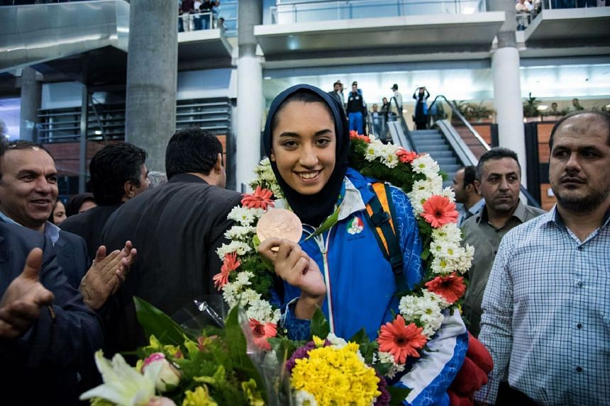 A 2016 photo shows Kimia Alizadeh with her medal at Imam Khomeini International Airport in Teheran.