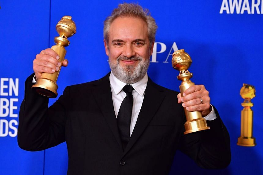 British film director Sam Mendes poses in the press room with his awards.