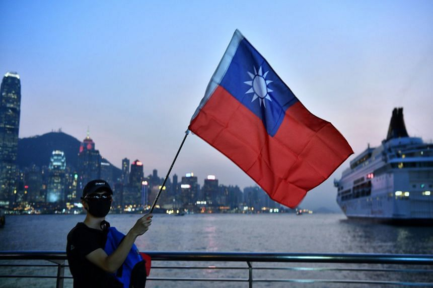 A photo taken on Oct 10, 2019, shows a protester waving the Taiwan flag in Hong Kong.