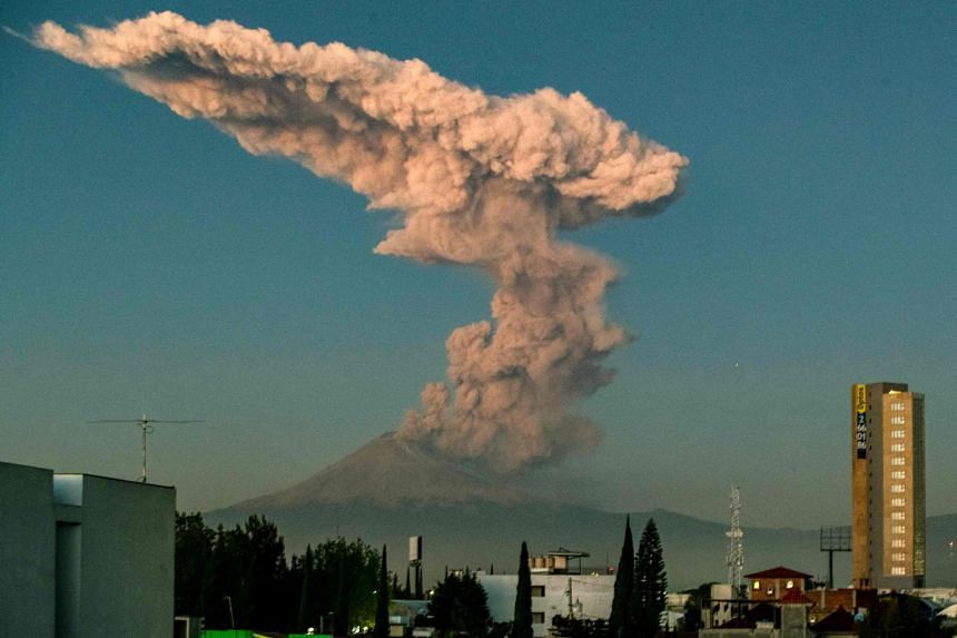 Popocatepetl spews ash and smoke as seen from Puebla, central Mexico, on Jan 9, 2020.
