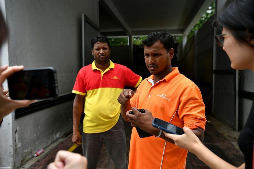 Bangladeshi cleaners Mostafa Kamal (left) and Patwari Shamim found the baby in a bin in Bedok North.