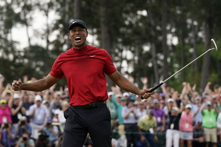 An April 2019 photo shows Woods celebrating as he wins the Masters golf tournament in Augusta.