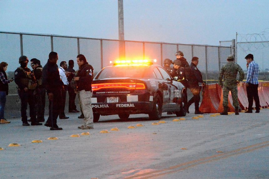 Police officers at the crime scene where a Mexican asylum-seeker slit his own throat after being denied entry into the United States, at the Pharr–Reynosa International Bridge, on Jan 8, 2020.