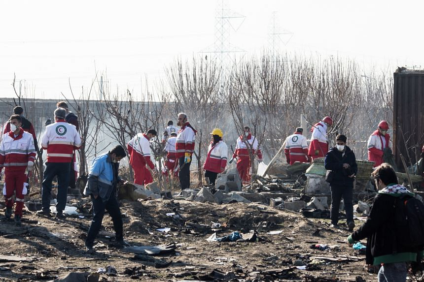 Rescue workers at the site of a Ukraine International Airlines crash on the outskirts of Teheran, Iran, on Jan 8, 2020.