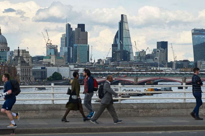 A photo taken on May 23, 2016, showing the skyline of central London with pedestrians in the foreground.