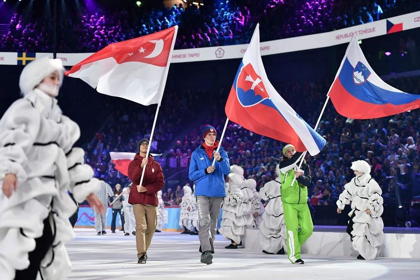 (From left) Singapore's ice hockey player Matthew Hamnett, Slovakia's ski mountaineer Matus Cernek, Slovenia's alpine skier Martin Krizaj at the opening ceremony of the Lausanne 2020 Winter Youth Olympic Games, on Jan 9, 2020.
