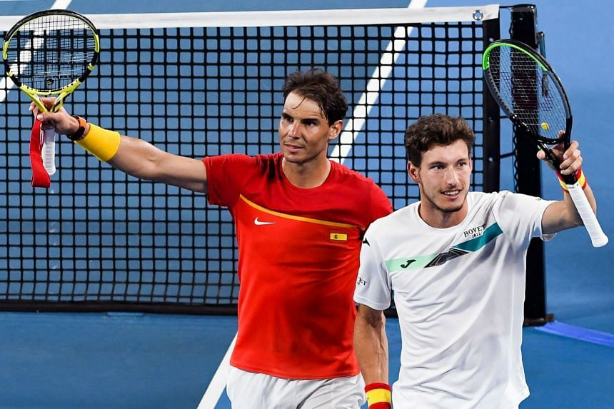 Rafael Nadal (left) and Pablo Carreno Busta of Spain celebrate winning their doubles match.