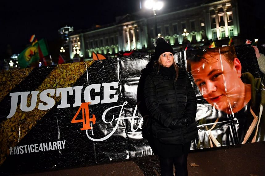 Harry Dunn's mother Charlotte Charles poses in front of a banner outside Buckingham Palace as people demonstrate during US President Donald Trump's visit for a Nato summit in London.