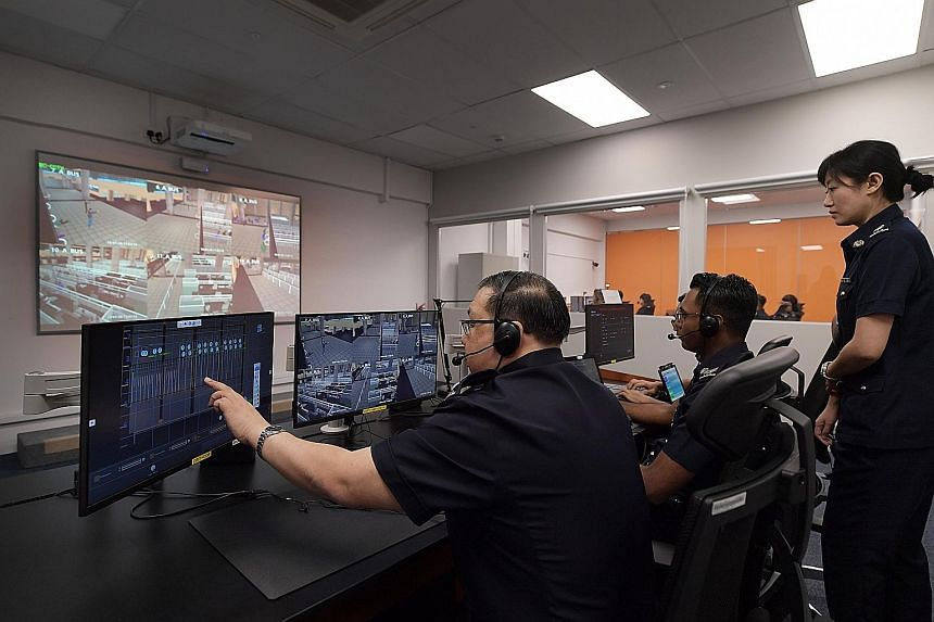 The training simulation system at the old Woodlands Checkpoint. Different simulated scenarios, such as an attack by gunmen, are played out on computer screens, and officers must coordinate their responses with one another.