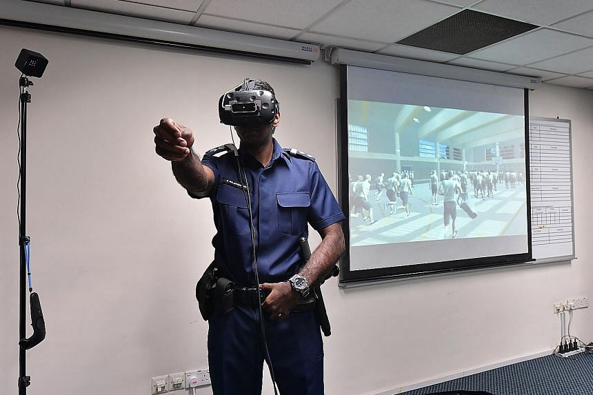 A trainee prison officer attempting to engage with a virtual inmate during VR scenario-based training at the Home Team Academy in Choa Chu Kang.