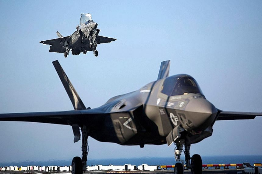 The F-35B jets (left), which can take off from shorter runways and land vertically, are meant to replace Singapore's ageing F-16 fleet, which has been in service since 1998. PHOTO: REUTERS