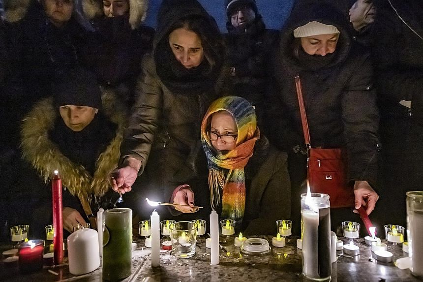 A vigil in Toronto, Canada, on Thursday for those killed in the crash. Among those who died were 63 Canadian citizens.