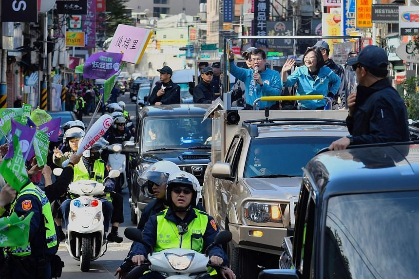 Taiwan President Tsai Ing-wen (above, right), from the ruling Democratic Progressive Party, campaigning in the Banqiao district in New Taipei City yesterday. In Ms Tsai's first election victory in 2016, only 57.73 per cent of eligible young voters ag