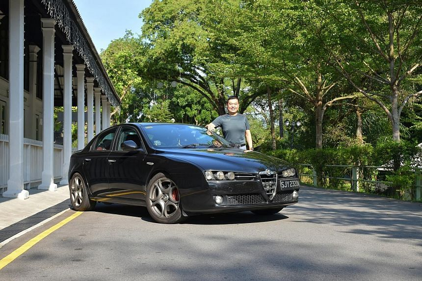 Property agent Elgin Lim connects his smartphone to the Alfa Romeo 159's on-board diagnostics module so he can be alerted to faults as soon as they arise.
