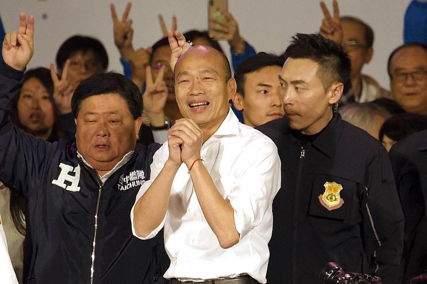 Kuomintang candidate Han Kuo-yu greeting the crowd at a campaign rally in southern Taiwan's Kaohsiung city yesterday. Polls have shown that middle-aged and older voters form the bulk of his supporters. PHOTO: ASSOCIATED PRESS