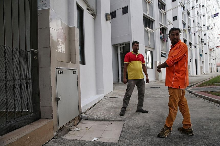 Bangladeshi cleaners Patwari Shamim (right) and Mostafa Kamal at the rubbish chute at Block 534 Bedok North Street 3, where the baby was found inside a plastic bag in the bin. The two men heard crying while they were on a buggy collecting rubbish, an