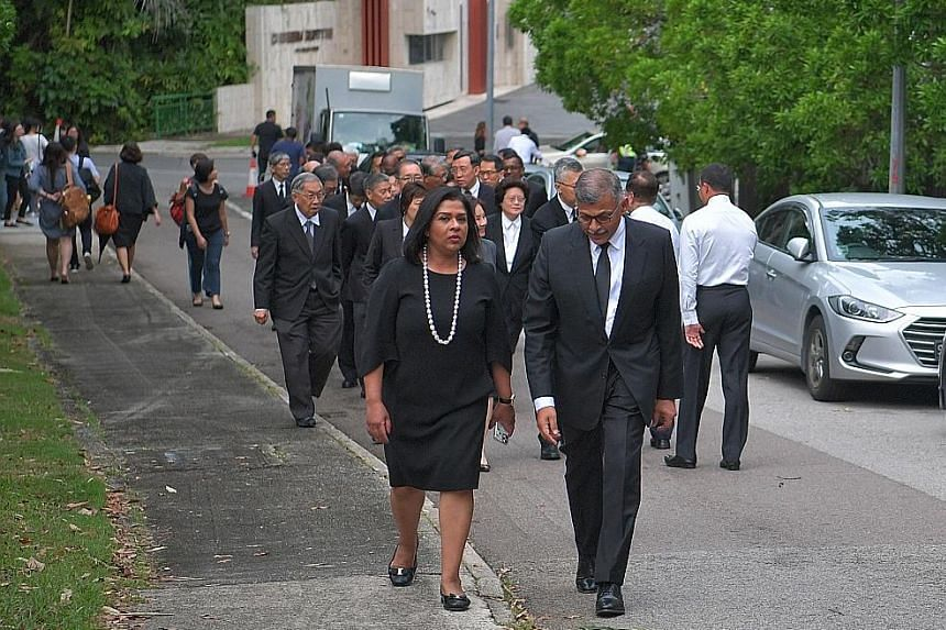 "Chief Justice Sundaresh Menon arriving at the wake with his wife. He described Mr Yong as having ""a wonderful heart for the people who worked with him"". Ms Phyllis See (centre, in white), speaking to reporters at the wake yesterday. Ms See, 71, was s"