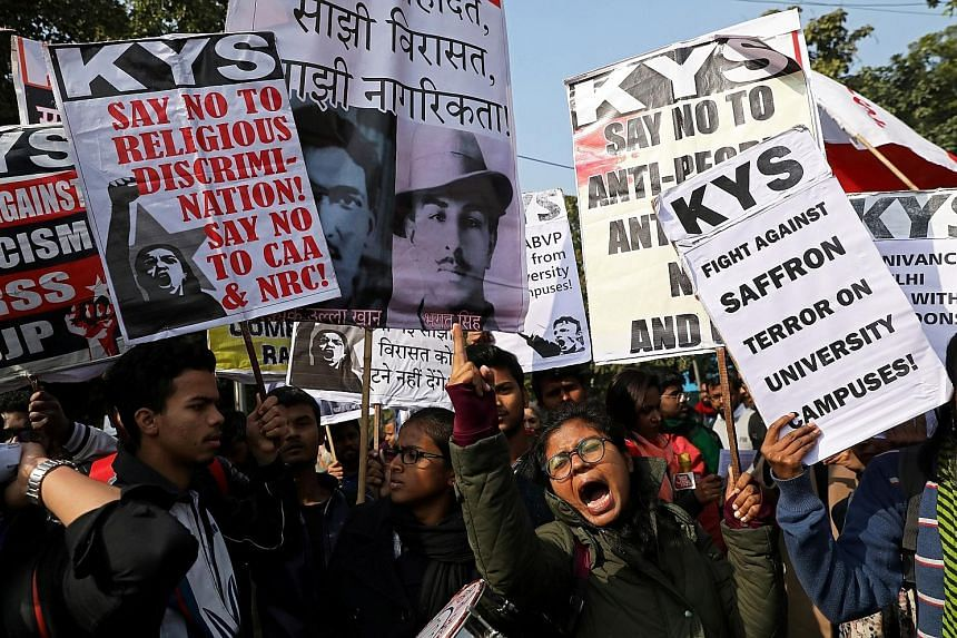 Demonstrators carrying placards and shouting slogans during a protest march on Thursday against the Jawaharlal Nehru University attacks.