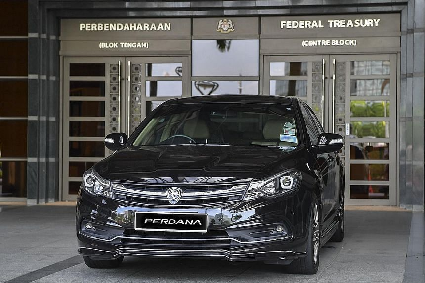 News that ministers would be using the Toyota Vellfire instead of the Proton Perdana (above) had sparked a public debate, with many questioning the need to use luxury cars with the country mired in debt.