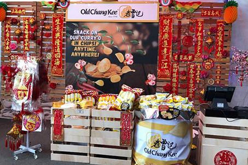 The Old Chang Kee CNY Makan Food Street sells food items such as the Curry Puff Flavour Potato Chips festive pack, crispy prawn rolls and other Chinese New year merchandise. PHOTO: OLD CHANG KEE