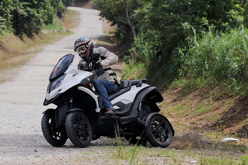 The four-wheeled Quadro Qooder can grip corners better than conventional motorcycles. It is also able to drift into turns and absorb potholes better.