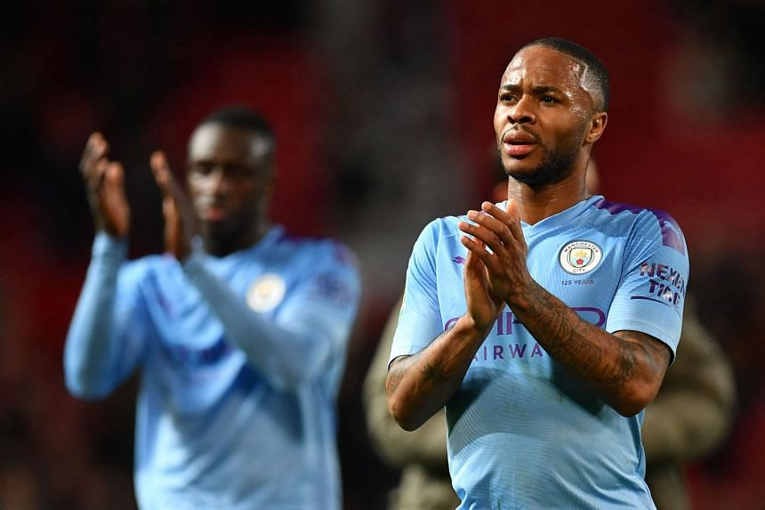Sterling applauds fans following a League Cup match against Manchester United.