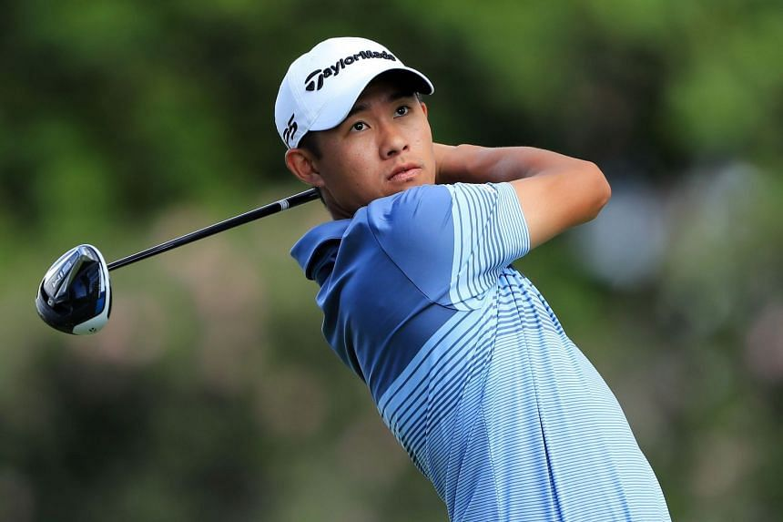Morikawa plays his shot from the eighth tee during the first round.