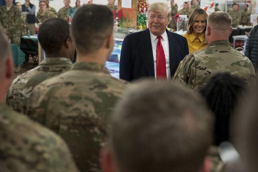 A 2018 photo shows Donald and Melania Trump visiting Ain al-Asad air base in Iraq.