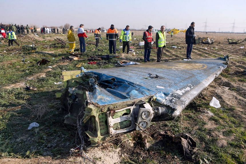 In this handout photo provided on Jan 8, 2020, rescue teams work at the scene of a Ukrainian airliner that crashed shortly after take-off near Imam Khomeini airport in Teheran.