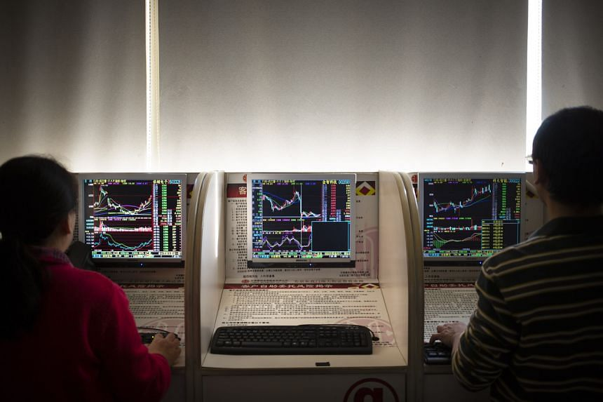 Chinese investors use computer terminals as they monitor stock prices at a brokerage house in Beijing on Jan 10, 2020.