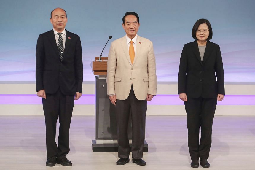 In this picture taken on Dec 29, 2019, Taiwan's presidential election candidates Tsai Ing-wen of the Democratic Progressive Party, James Soong of the People First Party and Han Kuo-yu of the Nationalist Party are seen at the start of their televised