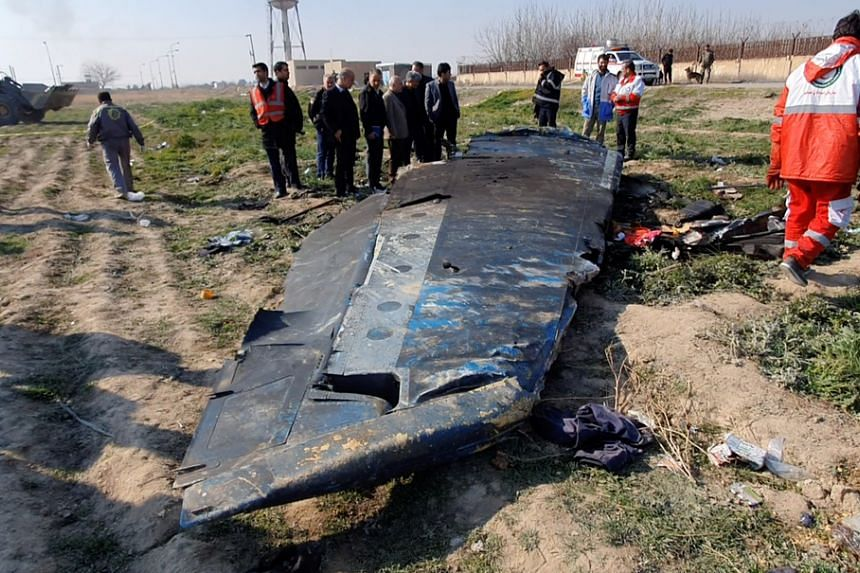 Debris of the Ukraine International Airlines plane that crashed after take-off from Iran's Imam Khomeini airport, near Teheran,, on Jan 8, 2020.