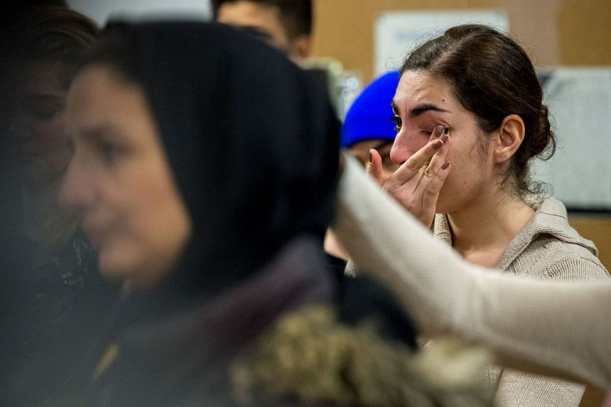 Mourners attend a vigil in memory of Iranian student Amir Moradi, who was killed in the crash of a Ukrainian passenger plane near Teheran, at Queens University in Kingston, Ontario, on Jan 10, 2020.