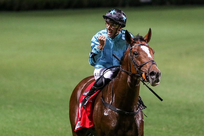 Jockey Alberto Sanna celebrates after winning on Last Kingdom on Sept 11 last year. The horse gave jockey Lyle Hewitson his first Hong Kong victory on Dec 29 and the new combination can score another all-the-way victory in Race 8 at Sha Tin today.