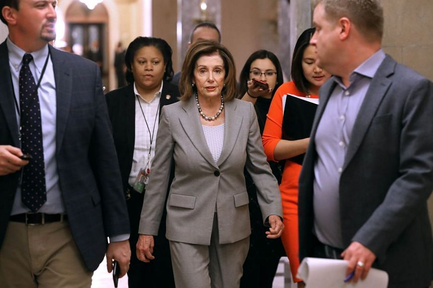 Pelosi heads back to her office after leaving the House Chamber at the US Capitol, Jan 10, 2020.