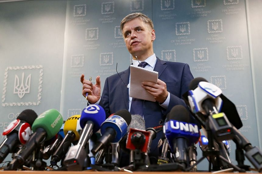 Ukrainian Minister for Foreign Affairs Vadym Prystayko gestures while speaking to the media in Kiev.