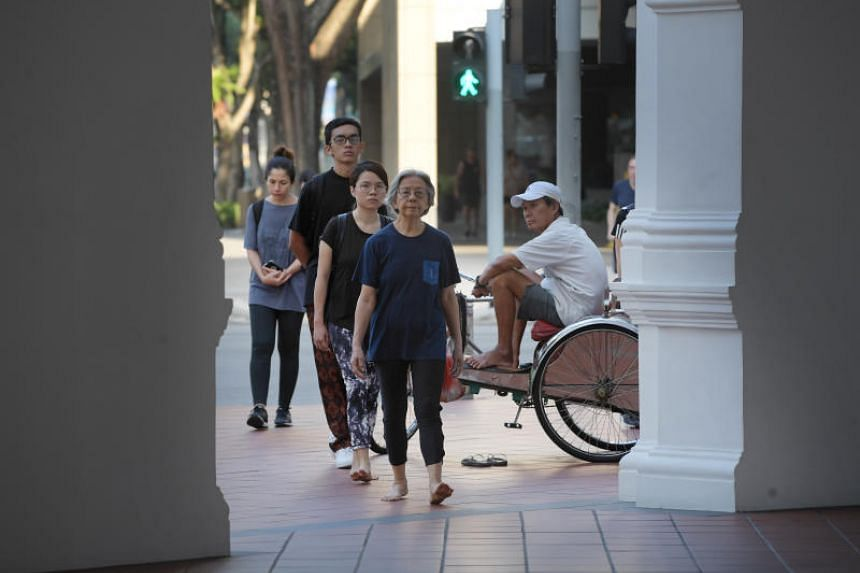 Artist Amanda Heng performs a reprise of her classic performance art piece as part of Singapore Biennale, walking from the Singapore Art Museum to the Esplanade and back several times.